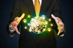 Businessman holding a social media globe Stock Image