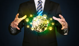 Businessman holding a social media globe Stock Photo