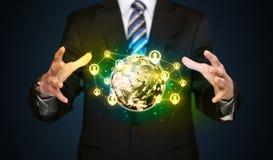 Businessman holding a social media globe Stock Photo