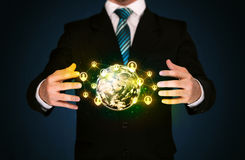 Businessman holding a social media globe Stock Images