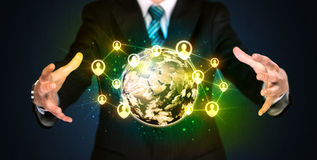 Businessman holding a social media globe Royalty Free Stock Photo