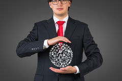Businessman holding social media icons Royalty Free Stock Photography