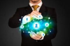Businessman holding social media network Stock Image