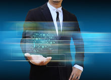 Businessman holding social network icons. Royalty Free Stock Photos