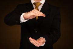 Businessman holding something royalty free stock images