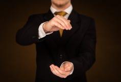 Businessman holding something Royalty Free Stock Photo