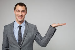 Businessman holding something imaginary in his hand and l Royalty Free Stock Images