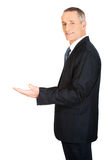 Businessman holding something invisible Royalty Free Stock Photography