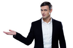 Businessman holding something on a palm. Handsome businessman holding something on a palm Stock Photo