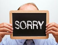 Businessman holding sorry sign Royalty Free Stock Photos