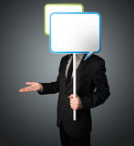 Businessman holding speech bubble Royalty Free Stock Photo