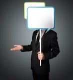 Businessman holding speech bubble Royalty Free Stock Photo