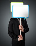 Businessman holding speech bubble Royalty Free Stock Photography