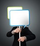Businessman holding speech bubble Stock Images