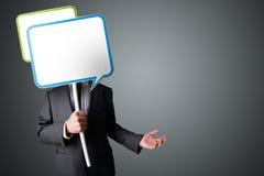 Businessman holding speech bubble Royalty Free Stock Photos