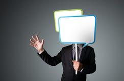 Businessman holding speech bubble Stock Photography