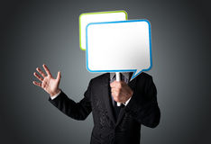 Businessman holding speech bubble Stock Photo