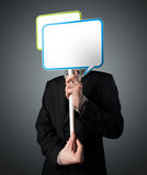 Businessman holding speech bubble Stock Images