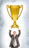Businessman holding sport cup Royalty Free Stock Photo