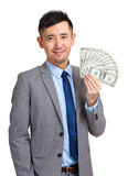Businessman holding spread of cash Royalty Free Stock Photos