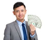 Businessman holding spread of money Royalty Free Stock Image