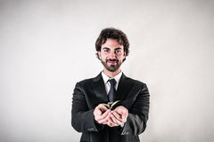 Businessman holding a sprout stock photo