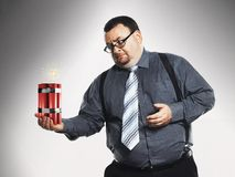 Businessman Holding Sticks Of Dynamite Stock Photos
