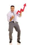 Businessman holding stock arrow Stock Image