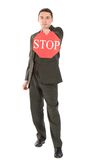 Businessman holding stop sign Royalty Free Stock Photo