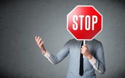 Businessman holding a stop sign Stock Photos
