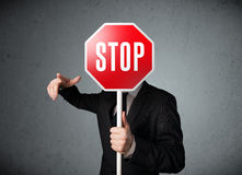 Businessman holding a stop sign Stock Images