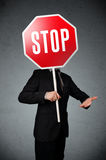 Businessman holding a stop sign Stock Photo