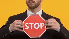 Businessman holding stop sign, stop corruption, taking bribes by civil servants. Stock footage stock footage