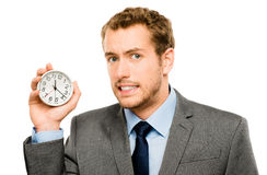 Businessman holding stop watch clock white background Royalty Free Stock Images