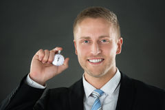 Businessman Holding Stopwatch In His Hand. Portrait Of A Businessman Holding Stopwatch In His Hand Stock Photo