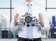 Businessman holding success plan Stock Image