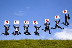 Businessman holding success text  and jumping Stock Image