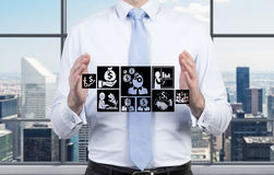Businessman holding symbol Royalty Free Stock Photo