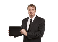 Businessman holding a tablet Stock Images