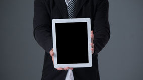 Businessman holding tablet Royalty Free Stock Image