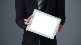 Businessman holding tablet Stock Images