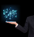 Businessman holding a tablet. Business communication. On the network interface to internet and world wide web connection on speed 5 generation. 5G, 3G, 4G Royalty Free Stock Image