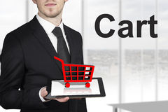 Businessman holding tablet cart Royalty Free Stock Photography
