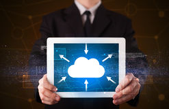 Businessman holding tablet with cloud icon Royalty Free Stock Image