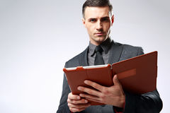 Businessman holding tablet computer Stock Photos