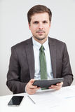 Businessman holding a tablet computer Stock Photos