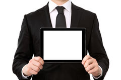 Businessman holding a tablet computer with isolated screen Royalty Free Stock Photography