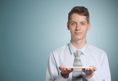 Businessman holding tablet computer Stock Image