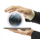 Businessman holding tablet and earth globe Stock Photography