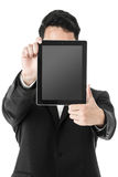 Businessman holding a tablet in face Stock Photography